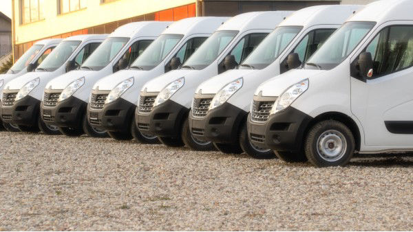 Fleet of Work Vans Lined Up