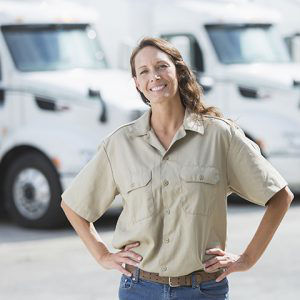 Fleet manager in front of vehicles