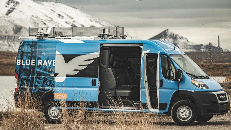 Cargo Van Crew Cab Conversion with Vinyl Wrap and Roof Rack Image