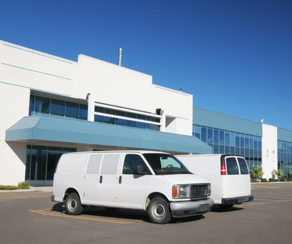 Locksmith vans in front of a building